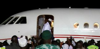Former Gambian president Yahya Jammeh boards a plane at the airport as he flees into exile