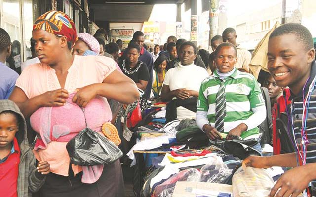 Street vendors sell school uniforms and stationery to last-minute back-to-school shoppers in Harare yesterday. — (Picture by Tawanda Mudimu)