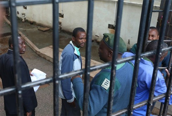 Pastor Mugadza being led away by prison guards