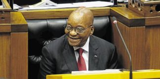President Jacob Zuma reacts as Economic Freedom Fighters MPs hurl insults at him before delivering his State of the Nation speech. Image by: ESA ALEXANDER
