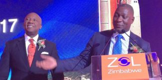 Information Communication Technology, Postal and Courier Services Minister Supa Mandiwanzira addresses delegates while ZOL Zimbabwe chief executive Denny Marandure looks on
