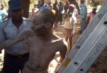 Police rescue Andrea Zunga from the chimney in Makokoba, Bulawayo