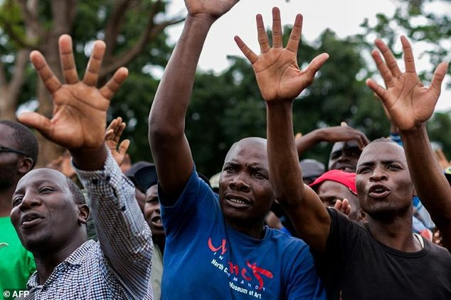 Supporters of Zimbabwe opposition leader Morgan Tsvangirai take part in a Harare rally by the main opposition parties calling for free and fair elections next year
