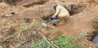 More misery for grieving families. . . burials in water-logged graves