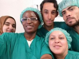 Mrs Jairos poses with some of the medical staff during her Iraq tour