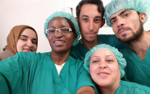 war zone..Mrs Jairos poses with some of the medical staff during her Iraq tour