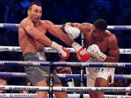 Anthony Joshua throws a punch at Wladimir Klitschko during the fourth round of their IBF, IBO and WBA, world heavyweight title fight at Wembley. Photograph: Ben Stansall/AFP/Getty Images