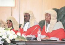 The new Chief Justice Luke Malaba (centre) seen here with his now predecessor Godfrey Chidyausiku (right).