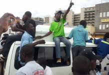File Picture: Touts sing and parade the coffin of a departed colleague on top of a commuter omnibus (Picture by NewsDay)