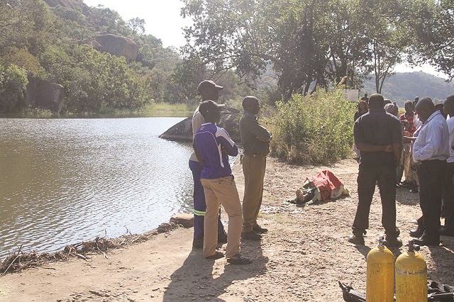 Some of the people who witnessed the retrieval of the late Tichawona Nyamande's body from Maleme Dam inside Matopo National Park on Monday