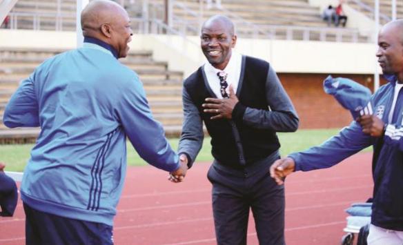 Dynamos coach Lloyd Mutasa shows his respect as he greets his mentor and ZPC Kariba coach Sunday Chidzambwa