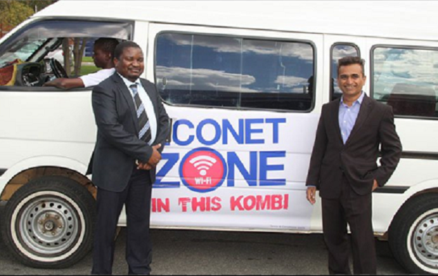 Econet-Wireless-Zimbabwe-head-of-broadband-Matthew-Masiyazi-left-and-chief-commercial-officer-Navdeep-Kapur-stand-in-from-of-a-commuter-omnibus-which-allows-commuters-to-the-browse-internet-using-Wi-Fi-
