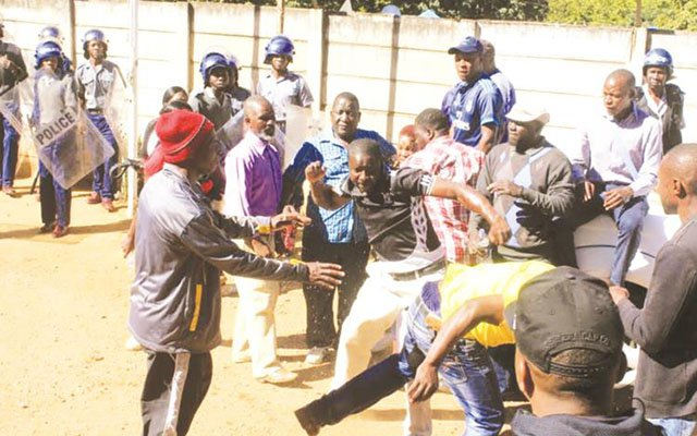 Zanu-PF Youth League members fight at the party's offices at Davies Hall in Bulawayo