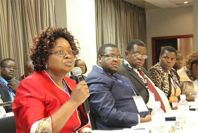 Auditor-General Mrs Mildred Chiri (left) addresses the Institute of Chartered Accountants of Zimbabwe workshop on Bridging the Gap: Auditing in the Public Sector