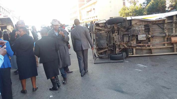 Seven school pupils escaped death by a whisker in Harare yesterday when a commuter omnibus they were travelling in overturned along Kwame Nkrumah Avenue while police officers on a motorcycle were in hot pursuit.