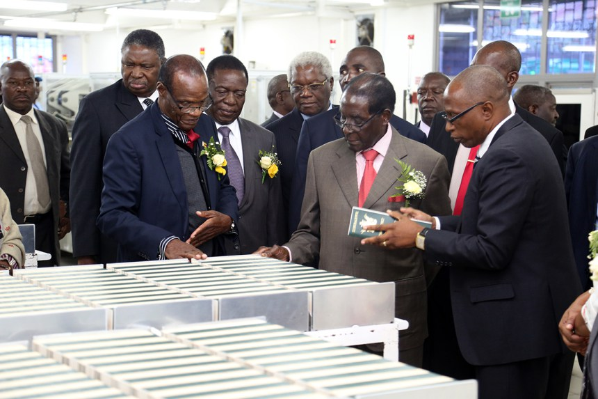 President Mugabe is taken through passport production stages by the Registrar-General Tobaiwa Mudede and his the Head of Information Technology Mr Henry Machiri (right) while Vice Presidents Phelekezela Mphoko and Emmerson Mnangagwa and Home Affairs Minister Dr Ignatius Chombo look on after the official opening of the National Passport Production Centre in Harare