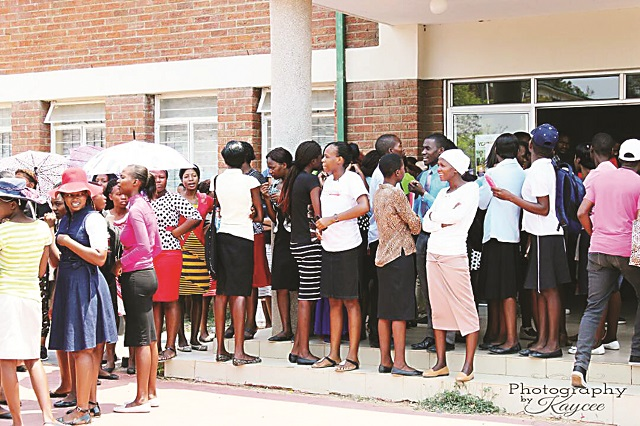 File picture of Solusi University students waiting to be addressed by management during a protest (Photography by Kaycee)