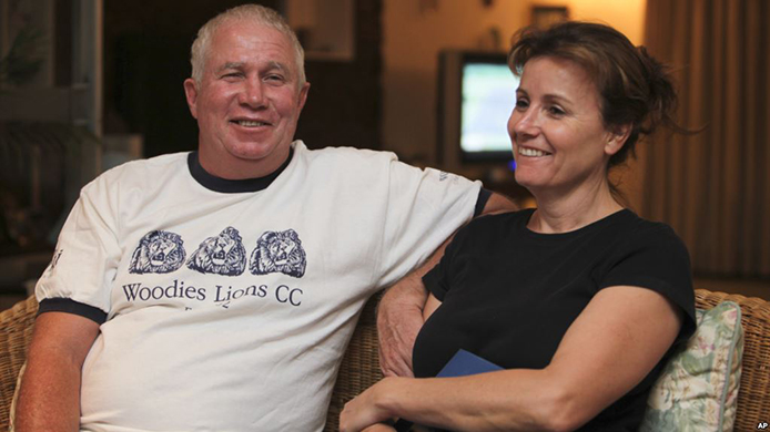FILE - This Oct. 16, 2009 file photo shows Senior Zimbabwean MDC opposition official Roy Bennett, left, and his wife Heather, relax at a friends home in Mutare about 200 km east of Harare, following his release from prison. A fiery helicopter crash killed Bennett and his wife, while on holiday in a remote part of the U.S. state of New Mexico and four others aboard, friends and authorities said. (AP Photo/Tsvangirayi Mukwazhi,File)