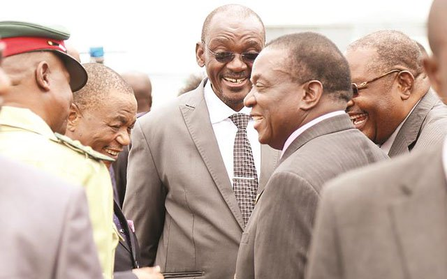 President Emmerson Mnangagwa converses with Vice Presidents General Constantino Chiwenga (Retired) and Kembo Mohadi on his arrival at Robert Gabriel Mugabe International Airport in Harare from the 30th Ordinary Session of the African Union Assembly. Looking on are Zimbabwe Defence Forces Commander Phillip Valerio Sibanda and Home Affairs Minister Obert Mpofu. — (Picture by Believe Nyakudjara)