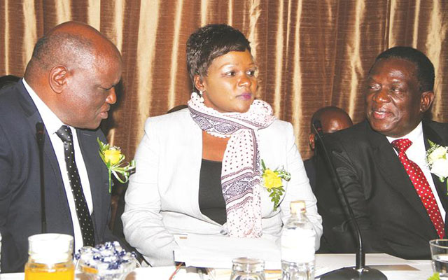 Then Vice President Emmerson Mnangagwa (right) chats with Chief Justice Luke Malaba (left), while Justice, Legal and Parliamentary Affairs Secretary Mrs Virginia Mabhiza looks on during the launch of Prosecuting Authority of Zimbabwe Strategic Plan document in Harare. — (Picture by Justin Mutenda)