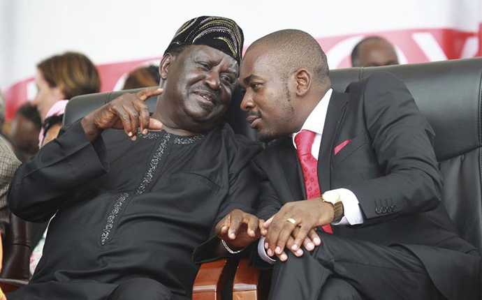 Kenyan Opposition leader Ralia Odinga, left, speaks to Zimbabwean Movement for Democtratic Change acting President, Nelson Chamisa during the burial ceremony of Morgan Tsvangirai in Buhera, Zimbabwe about 200 kilometres south east of Harare, Tuesday, Feb, 20, 2018. Zimbabwe's veteran opposition leader Morgan Tsvangirai, aged 65, died Feb 14 and was laid to rest at his rural home in Buhera. (Tsvangirai Mukwazhi - AP)