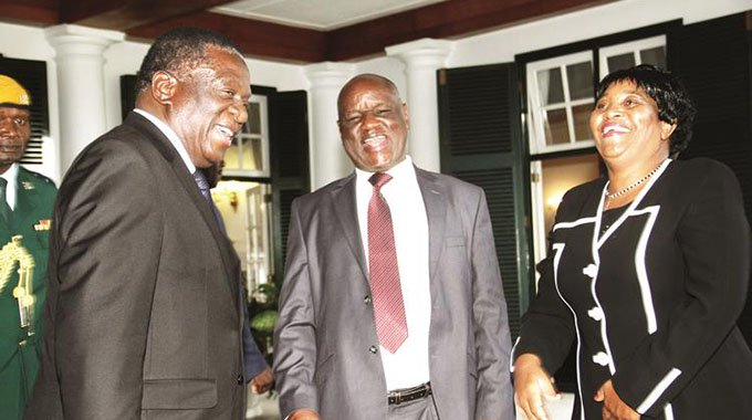 President Emmerson Mnangagwa shares a lighter moment with Chief Justice Luke Malaba (centre) and his new deputy, Justice Elizabeth Gwaunza, after her swearing-in at State House in Harare yesterday. -Picture by John Manzongo