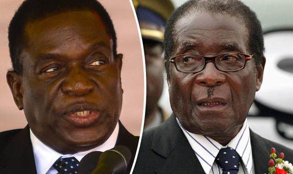 Then Zimbabwean President Robert Mugabe flanked by his then deputy Vice President Emmerson Mnangagwa