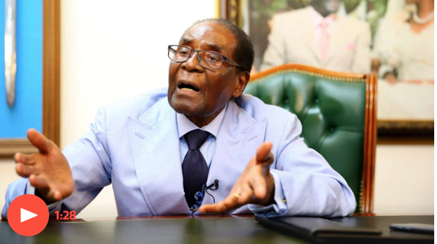 Former President Robert Mugabe speaking to the media