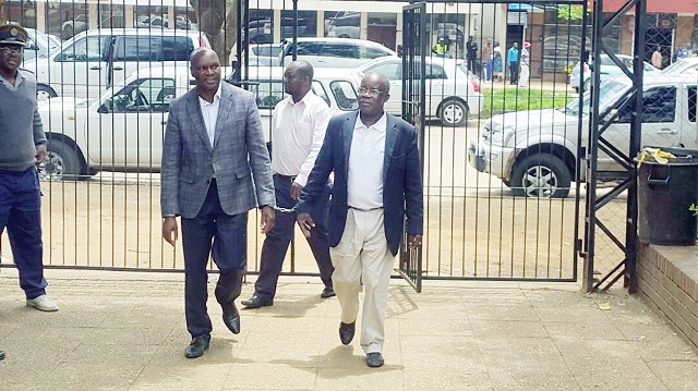 Former Minister Walter Chidhakwa and Prof Francis Gudyanga arrive at Gweru Magistrates' Court