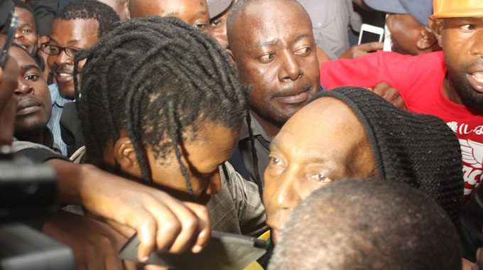 """Legendary chimurenga musician Thomas """"Mukanya"""" Mapfumo was all smiles seeing scores of fans when he landed at the Robert Mugabe International Airport on Wednesday night."""