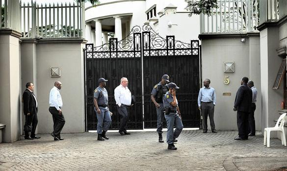 Members of the Asset Forfeiture Unit, Sars, the Hawks and the SAPS implement a search-and-seizure high court order at the mansion of the Gupta brothers in Saxonwold. Picture: Matthews Baloyi/African News Agency (ANA)