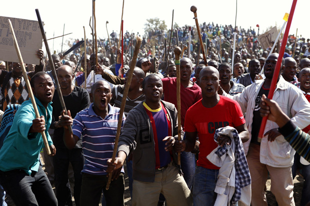 File picture of protestors armed with assegais and knobkerries in South Africa