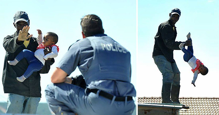 A South African man has been charged in court with child abuse after throwing his one-year-old daughter from the roof of a shack last week.
