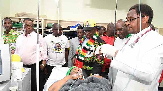 President Mnangagwa flanked by Vice President Constantino Chiwenga and Minister of Health and Child Care Dr David Parirenyatwa visit injured Zanu-PF chairperson Cde Oppah Muchinguri-Kashiri in a Bulawayo hospital after the bomb blast, which killed two people and injured more than 40 others.