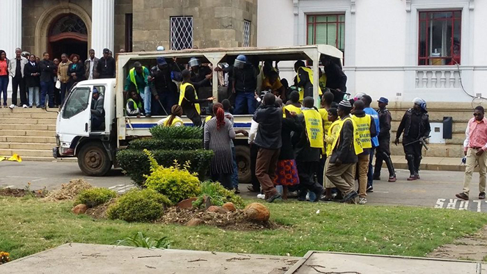 File picture of riot police disrupting a protest by vendors outside Harare Town House