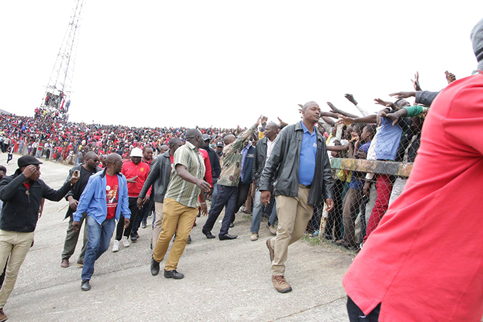 Nelson Chamisa greets the ecstatic crowd inside Sakubva Stadium in Mutare