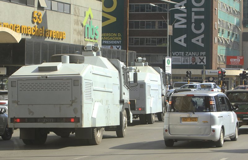 Image result for images of police water cannons in harare election