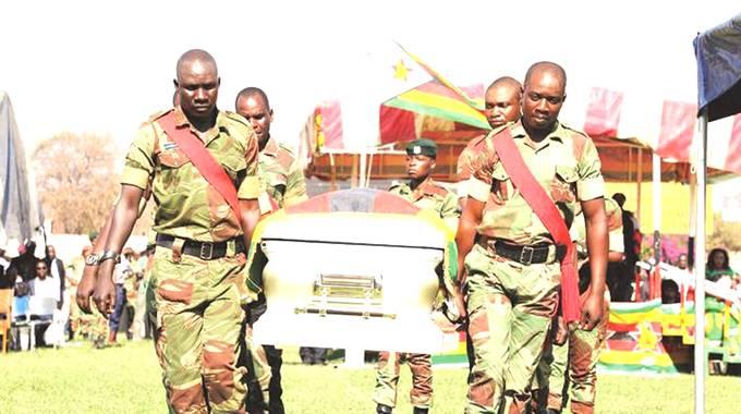 Pallbearers carry a casket bearing the body of national heroine Cde Thokozile Mathuthu at the Hwange Colliery Stadium yesterday