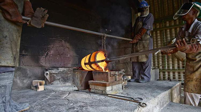 Blanket Mine workers process gold