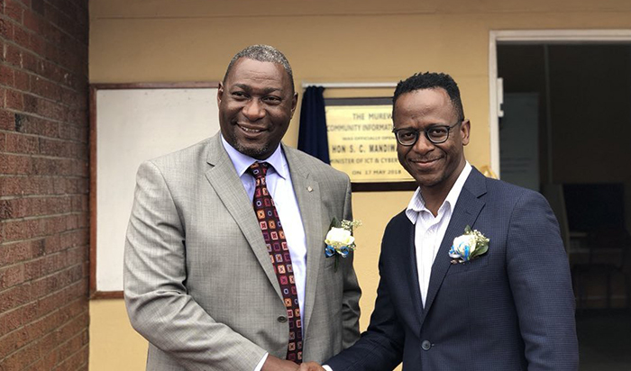 Minister of Information Communication Technology (ICT) and Cyber Security Mr Supa Mandiwanzira seen here with Lazarus Muchenje