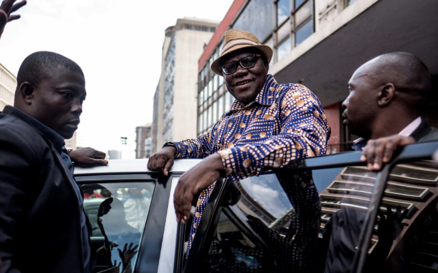 Former Zimbabwean Finance Minister and MDC Alliance member Tendai Biti greets supporters outside the MDC Alliance's headquarters in Harare on July 31 (CREDIT: MARCO LONGARI/AFP)