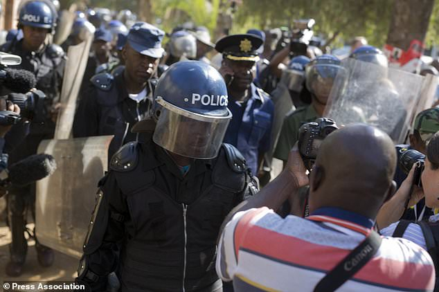 Riot police enter the Bronte hotel, where Mr Chamisa had been due to speak (AP)
