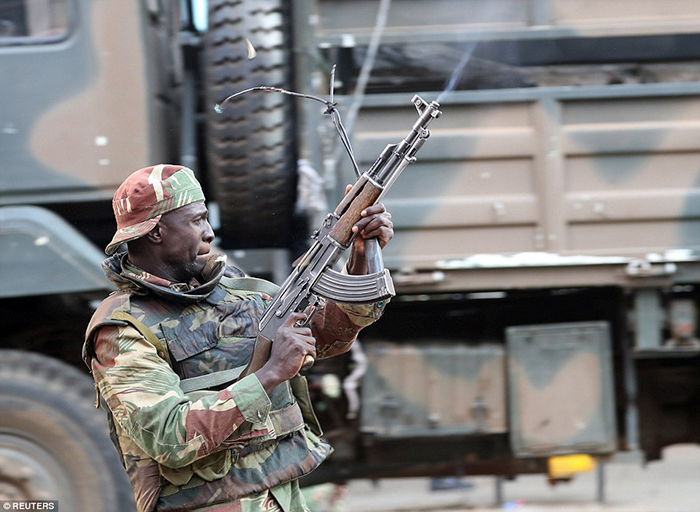 A soldier opens fire to disperse supporters of the opposition Movement for Democratic Change outside the party's headquarters in Harare, Zimbabwe