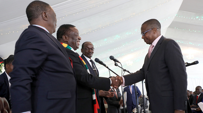 President Mnangagwa congratulates the new Finance and Economic Development Minister Professor Mthuli Ncube while flanked by Vice Presidents Constantino Chiwenga (left) and Kembo Mohadi at State House in Harare yesterday. — (Picture by Tawanda Mudimu)