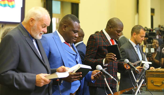 Kuwadzana East MP Chalton Hwende (second left) being sworn into Parliament. (Picture by Brighton Chihwayi - Photo Phactory Zimbabwe)