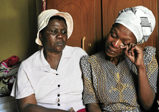 October 16 2018 Nokulunga Pita, 46, comforted by a fellow church member, Nonhlanhla Nkala, 56. Pita's son allegedly killed his sister and her 13-month-old son. (Pic Veli Nhlapo/Sowetan)