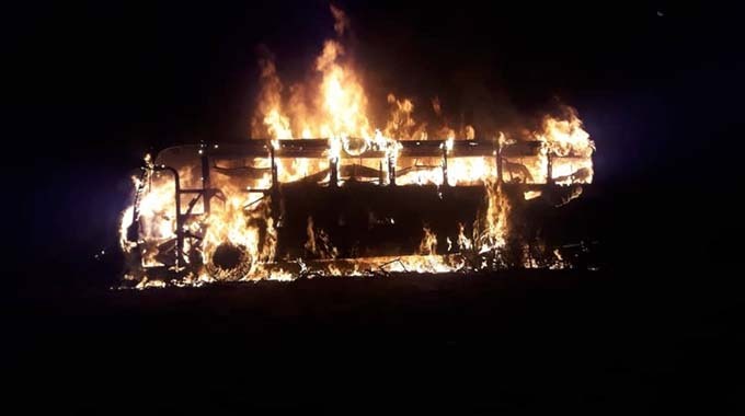This picture shows a Brooklyn Express coach engulfed in flames near West Nicholson in Matabeleland South Province on Thursday night .