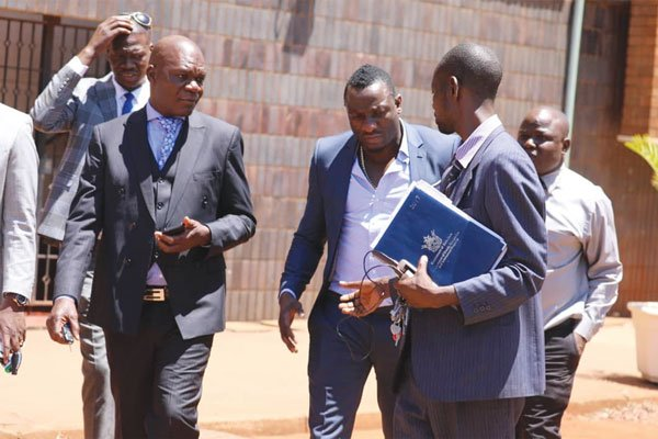 """Controversial businessman and socialite Genius """"Ginimbi"""" Kadungure was arrested as he left the Harare Magistrates' Courts on allegations of tax evasion amounting to $22 million. (Picture by NewsDay)"""