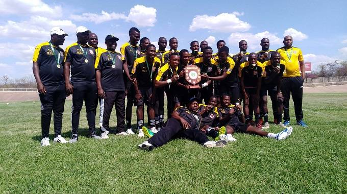 Hwange Football Club pose with the winners' trophy