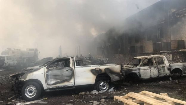 A photo released by the election commission shows vehicles damaged by the fire